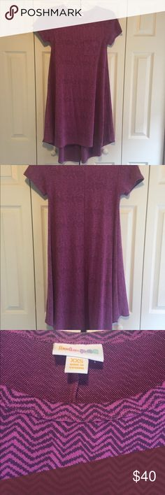 LulaRoe Xxs. Carly Spring LulaRoe. Carly Dress. Xxs. Worn once. So cute with leggings, tights, jeans or without. So comfortable. Knot it up .. Wear as a dress or shirt. So versatile.  This lavender color is so pretty for spring with a light grey zig zag pattern. This dress has a lot of fabric. Its flowy and pretty. I'm a size 4-6 and have a generous amount of room left. No modeling. No trades. Happy Poshing!!  **$$ Bundle and SAVE$$** LuLaRoe Dresses High Low