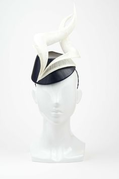The Eternal Headonist - Shelley - Black Leather Covered Topper with Hand Sculpted White Sinamay Twists by Lisa Tan Millinery 2014, $499.00 (http://www.theeternalheadonist.com/shelley-black-leather-covered-topper-with-hand-sculpted-white-sinamay-twists-by-lisa-tan-millinery/)