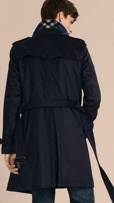 A Burberry trench coat introduced in pure cashmere with smart leather trims to the belted waist and cuffs.