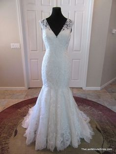 Description Allure Bridal Gown Style 9056 This beautiful style is created from a rich lace applique on soft net. The sculpted neckline features scalloped cap-sleeves and v-shaped neckline with a drama