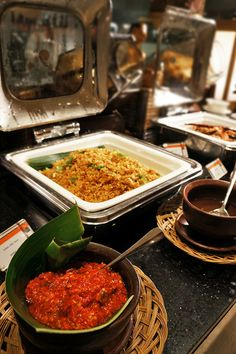 Sambal ulek (a type of chili sauce) is provided to accompany local guests' favorite dish, Nasi goreng (fried rice). Phot...