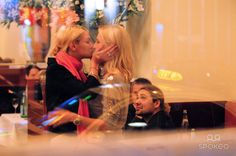 David Garrett watching as his two female companions kiss each other at Borchardt restaurant.