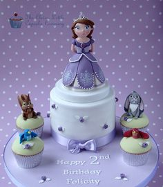 Sofia The First Cake Sugarpaste figure sitting on top of a chocolate cake. Matching cupcakes with the animal characters from the show. Princess Sofia Cake, Princess Theme Cake, Princess Cupcakes, Princess Party, Fondant Figures, Sofia The First Cake, Adult Birthday Cakes, 7th Birthday, Birthday Ideas