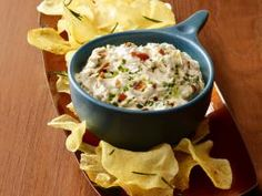 Roasted Garlic-Bacon Dip : Cut the tops off 2 heads garlic, drizzle with olive oil, wrap in foil and bake at 400 degrees until tender, 45 minutes. Sauté 1 roasted garlic pulp in olive oil over low heat until caramelized, 30 minutes
