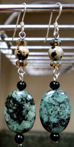 """Dark Fairy Earrings $15.00 Free Shipping! 2 1/4"""" Length-Sterling Silver earring wires. Beautiful green and black polished stone ovals with black beads dangling from Dalmatian Jasper stones matched with paint splashed Amber faceted glass."""