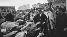 President John F. Kennedy greets supporters during his visit to Fort Worth, Texas, on Friday, November 22, 1963. This month marks 50 years since his assassination in Dallas, an event that jarred the nation and fueled a multitude of conspiracy theories about whether Kennedy was killed by a single gunman acting alone in the Texas School Book Depository.