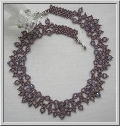 You can find this pattern here: http://store.sandradhalpenny.com/picot-beauty-necklace-pattern-p353.php