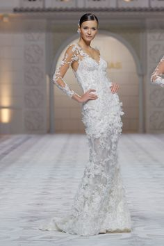 A wedding gown that looks like its made of flowers. Pronovias wedding gown.