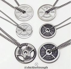 Some of Shields of Strengths weight plate necklaces!