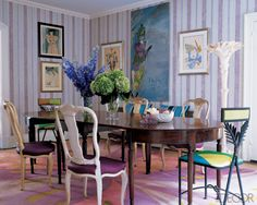The walls of writer Amy Fine Collins's dining room were painted with lilac, gold, and pale-blue stripes by artist Robert Hoven and the graphic candy-color carpet is by Gene Meyer for M&M Design International. Elle Decor, Dining Chairs, Dining Table, Dining Rooms, Dining Area, Mismatched Chairs, Sweet Home, Purple Rooms, Dining Room Design
