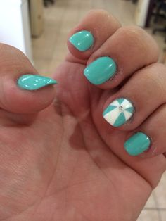 Light turquoise with a white cross and a little bling