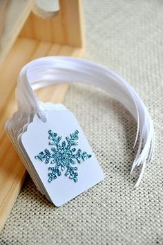 Snowflake Gift Tags are perfect for adding a little sparkle to your Frozen Inspired Party, Ice Princess Party or Winter Wonderland Party. Each tag features a light blue glitter snowflake embellishment. Using a matching set of gift tags for your party favors and presents can be a great way to give your party a very cohesive look. These snowflake tags would even be perfect as adorable napkin holders!