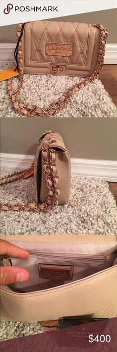 """⭐️Valentino Crossbody Bag⭐️ NWT Valentino Beatriz BagColor is cream color & Hardware is Rose Gold⭐️Can be used as a crossbody bag, clutch and double strap over the shoulder bagDetails:Partial chain shoulder strap  Foldover top with twist lock closure  Exterior features stitched border detail and textured front panel Interior features wall zip pocket Dust bagincludedApprox. 5"""" H x 8.25"""" W x 2"""" D  Approx. 21"""" strap dropMaterials: Genuine leather exterior, fabric lining NO TRADESLess on Ⓜ️…"""