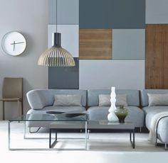 Mmmm - just our kind of Living Room. Contemporary shades of grey . . . cupboards from Ikea, table and sofa from Bo Concept.