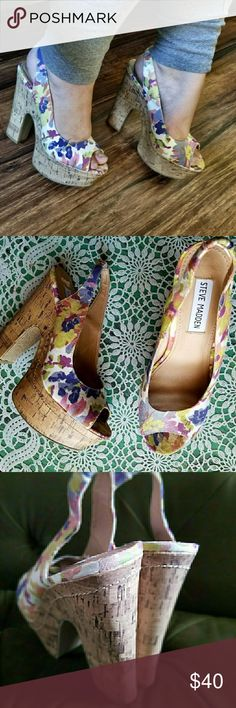 Steve Madden Floral Platforms Chic floral platforms. Love the floral design with a retro cork platform. Ankle strap in the back that has stretch. Condition: EUC ( the inside of the shoe there is some peeling, but no damage on the outside Retail: $80.00 Size: 7M Steve Madden Shoes Heels
