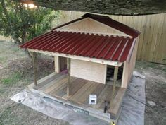 Built a duplex dog house for our two dogs! Cost: $230.00 #diditmyself