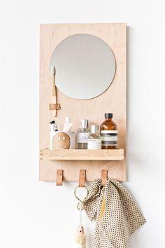 Learn how to make a modern DIY bathroom organizer (with mirror) out of scrap plywood. #diybathroom #bathroomorganizer #diyorganizer #diy #plywoodproject #modernbathroom