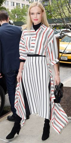 Kate Bosworth pitted stripes against stripes, stepping out in a look by Tome—a slouchy striped blouse layered over a black turtleneck and paired with a lined asymmetric skirt. The finishing touch? Thigh-high black suede Stuart Weitzman boots.