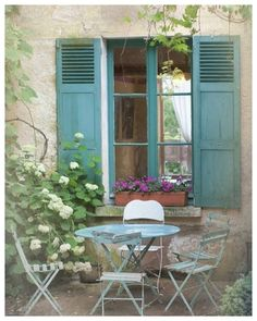 French country photography blue bistro table chairs shutters cottage window wall decor via decorative tiles French Country Cottage, French Country Style, Cottage Style, Country Blue, French Cottage Garden, Country Farmhouse, Cottage House, French Country Gardens, Farmhouse Decor