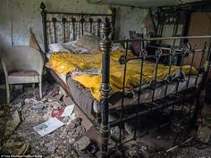 The couple's double bed is stil made up with sheets despite appearing not to have been slept in for more than half a century