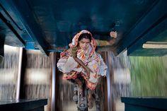 Bangladeshi woman riding between rail cars - Imgur