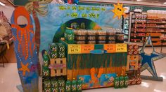 """WELCOME TO CAKE ISLAND AND BEVERAGE BAY IN SUNNY CAFÉ VALLEY!"""" Check out this FUN in the SUN entry from Piggly Wiggly #500 Deli Manager Angela Cowart and Store Manager Mike McNeal in Albertville, Alabama. Stop by and see it for yourself at 250 Alabama Highway 75 North! PHENOMENAL JOB TEAM!!!!"""