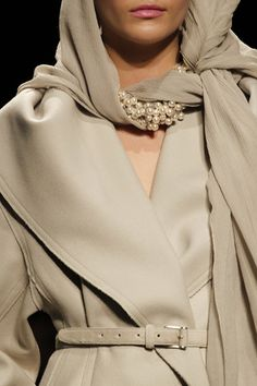 I love how this coat is glammed-up with the matching colour scarf with different textures and mix of beads. Giving it a real wow factor. Donna Karan