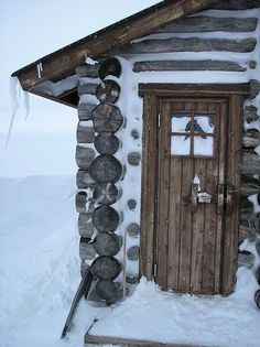 Winter - Log cabin in the Arctic