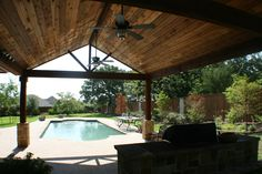 Texas covered patio ideas | The covered patio houses the beautiful outdoor kitchen finished with ...
