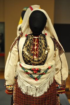 Costume from Macedonia    The Museum of International Folk Art in Santa Fe, New Mexico is hosting a wonderful exhibition of embroidered costumes from Macedonia. Here is a partial look at one of the costumes -- a young woman's festival dress from the Suva Gora area.