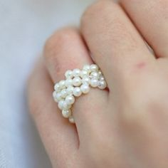 Learn how to make this continuous bead flower ring.