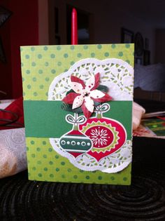 Using a doilie from the We R Memory Keeper's Tres Elegant collection & embellishments from their Peppermint Twist collection came together nicely...