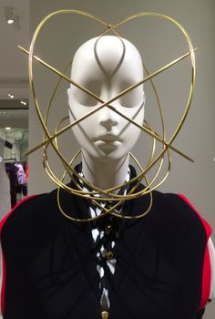 "Natasha Lawes headdresses on the mannequins at Selfridges in ""The Master's Exhibition"", pinned by Ton van der Veer"