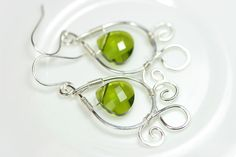 Hey, I found this really awesome Etsy listing at http://www.etsy.com/listing/126132584/green-swarovski-earrings-wire-wrapped