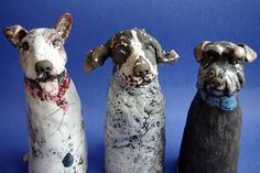 Lesley Martin ceramic dogs - love that these each have their own personality and as if they are having a conversation with the viewer!