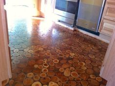 With Some Old Wooden Discs, They Transformed Their Disgusting Old Floor Into THIS. I Am Jealous