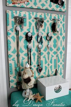 burlap stenciled jewelry organizer (I'd probably use wood, fabric, and drawer pulls instead. Or maybe modge podge scrapbook paper on wood?)