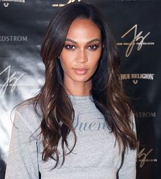 Joan Smalls pairs a glint of copper eye shadow with loose, barely-there waves