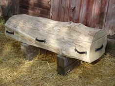 Solid Peeled Log Casket:This casket is made from one solid piece of white oak which has been peeled to reveal 120 golden rings. The dark and light variations within this wood highlight the perfect natural patina. Perfect for a log home owner or anyone who appreciates the simple, clean style.