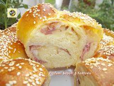 Treccia di pan brioche salata ripiena, è bella da vedere e buona da gustare ogni fetta rivela il ripieno di salame, prosciutto cotto e formaggio filante.