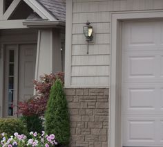 Combination of stone and shake siding on home #siding