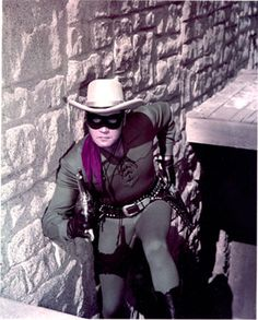 Clayton Moore holding a handgun in a publicity still issued for the television series, The Lone Ranger, USA, circa Clayton Moore, The Lone Ranger, Tv Westerns, Masked Man, We Movie, Western Movies, Old Tv Shows, Classic Tv, American Actors