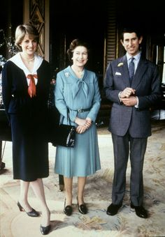 The Queen Elizabeth II poses with his son, Prince of Wales Charles, and his fiancee, Lady Diana Spencer, at Buckingham Palace, 27 March 1981.
