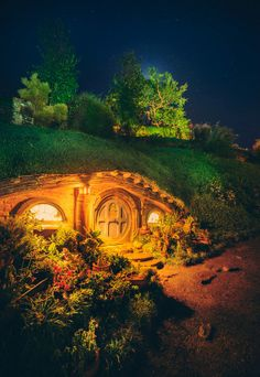 A Hobbit Hole in the Night by Trey Ratcliff Earthship, Fairy Houses, Middle Earth, Lord Of The Rings, Faeries, The Hobbit, Places To See, Beautiful Places, Scenery