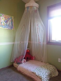 Reading nook with extra crib mattress and Ikea drape
