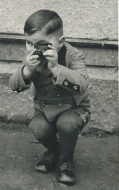 Are your kids taking photographs yet? It would be great to get photos from their angle & perspective and to take a photo of them with the camera.  I love this vintage shot!!