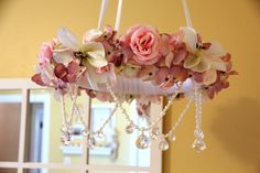 DIY Flower wreath mobile with crystals hanging above crib - baby girl