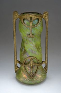 Rindskopf pale green iridescent mounted Art Nouveau metal frame, with striated decor.