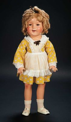 """Doll owned by Shirley Temple. 27"""" American Composition Doll of Shirley Temple by Ideal in Exclusive Costume The doll marked """"Shirley Temple Ideal N&TCo"""" was made by Ideal, under exclusive license, circa 1934, with original shoes and socks and in near mint condition. The doll is wearing an exclusive costume, home-or-studio-made for Shirley, inspired by a classic costume worn in """"The Littlest Rebel"""". Ideal, circa 1935. Z"""