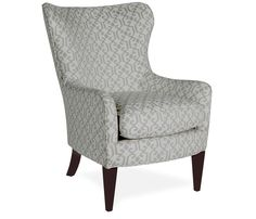 Modern wing chair, cozy but upright enough that you don't have to be hoisted out of it.